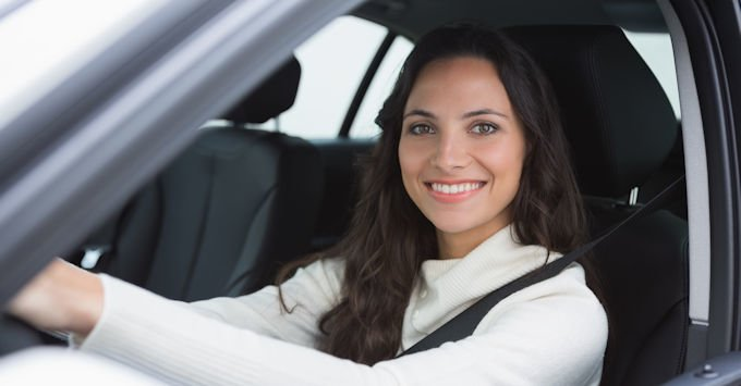 Young lady in her car