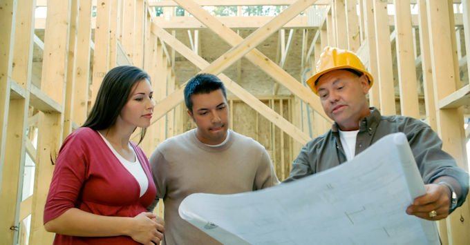 General contractor working with clients on the job site