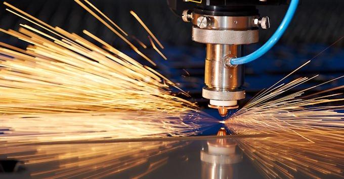 CNC machine cutting metal plate